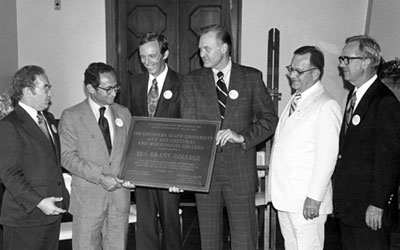 Historical Photo: Jack Van Lopik accepts the Sea Grant College plaque in 1978.